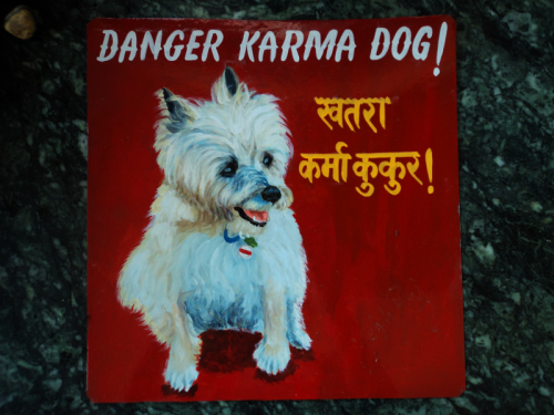 Folk art portrait of a rescue dog hand painted on metal in Nepal
