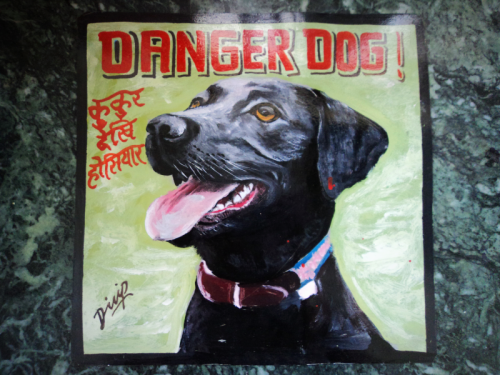 Folk art portrait of a Black Lab hand painted on metal in Nepal