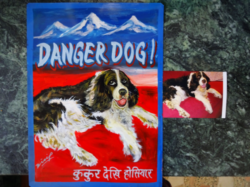 Folk art portrait of a Springer Spaniel hand painted on metal agianst a backdrop of the Himalayas