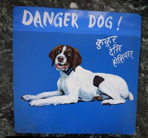 Folk art portrait of a Bedlington Terrier hand painted on metal in Nepal