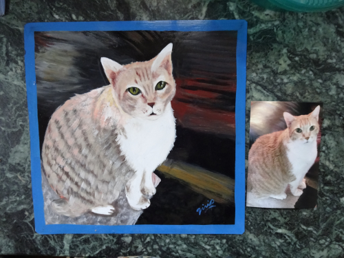 Folk art portrait of a Ginger Cat hand painted on metal in Nepal
