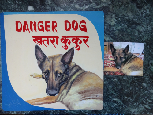 Folk art beware of dog portrait of a German Shepherd hand painted on metal in Nepal