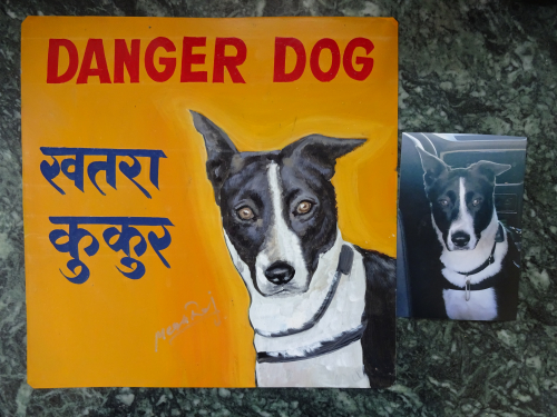 Folk art portrait of a Canaan Dog hand painted on metal in Nepal