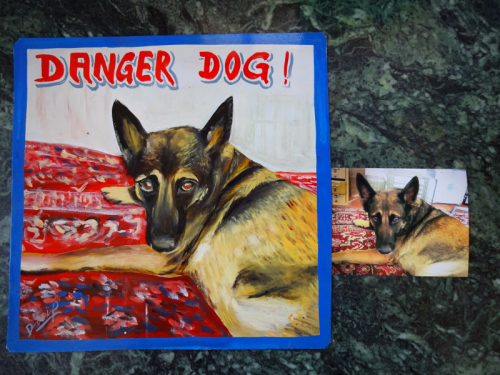 Folk art beware of dog sign with a German Shepherd hand painted on metal in Nepal