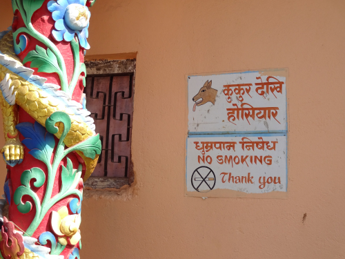 Beware of Dog sign on Buddhist Gompa in Nepal