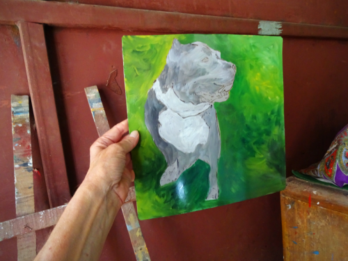 Folk art portrait of a Staffordshire Terrier Pit Bull hand painted on metal in Nepal