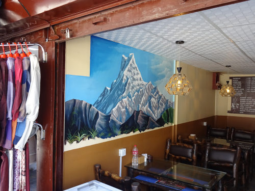 Mural in a Pokhara restaurant, featuring the Himalayas