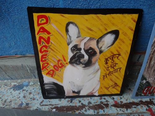Folk art portrait of a French Bulldog hand painted on metal