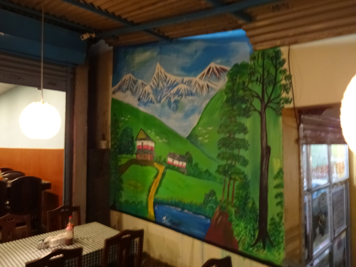 Mural of a Nepali village and a Himalayan moutain