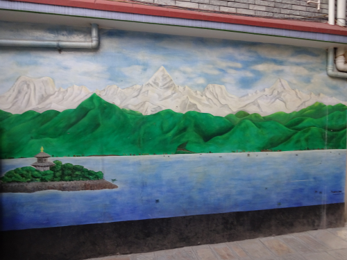 Mural of Lake Fewa with a mountain range in the background
