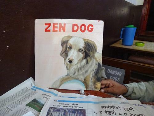Folk art portrait of a miniature Australian Shepherd hand painted on metal in Nepal