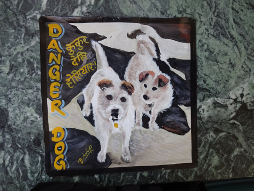 Folk art portrait of 2 Jack Russell Terriers hand painted on metal in Kathmandu, Nepal