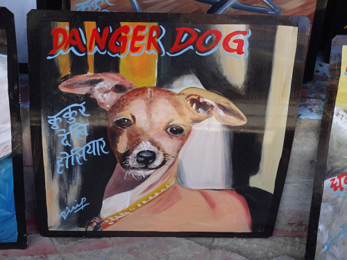 Folk art portrait of an Italian Greyhound hand painted on metal in Kathmandu, Nepal
