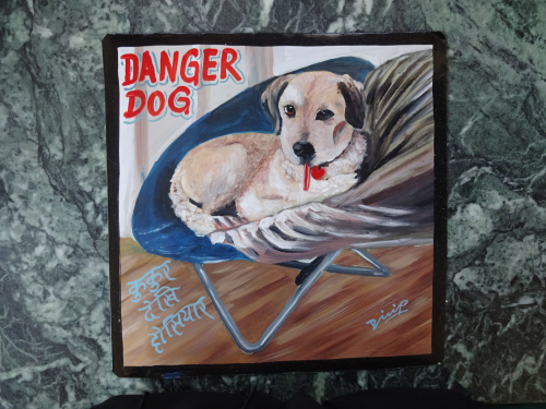 Folk art portrait of a dog in a chair hand painted in Nepal by a sign painter