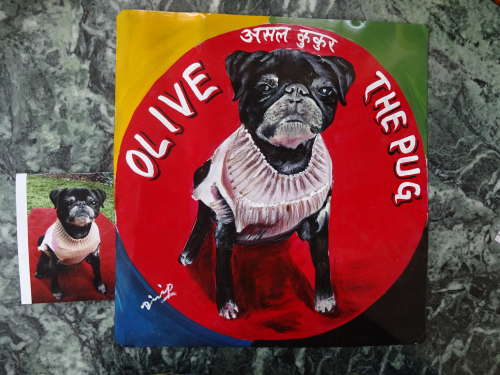 Folk art portrait of a black pug hand painted on metal in Kathmandu, Nepal