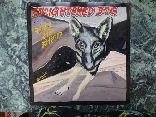 Folk art German Shepherd hand painted on metal in Kathmandu, Nepal