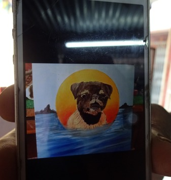 Folk art portrait of a black pug hand painted on metal  in Nepal