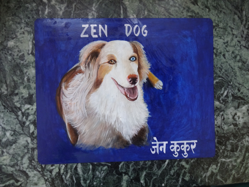 Folk art portrait of an Australian Shepherd hand painted on metal in Nepal