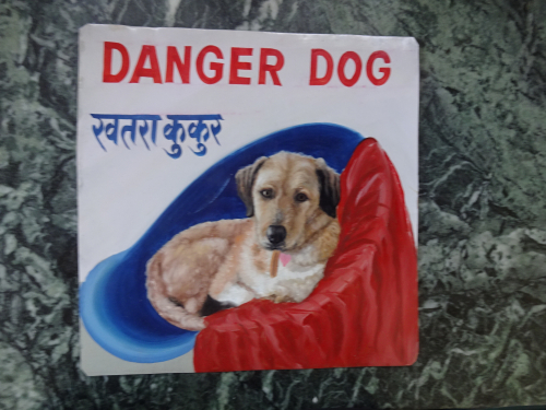 Folk art portrait of a mixed breed Terrier dog hand painted on metal in Kathmandu, Nepal