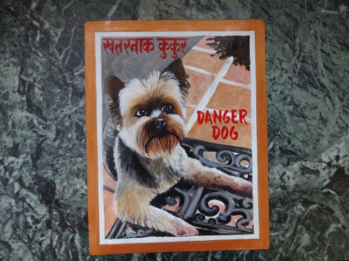 Folk art portrait of a Yorkie hand painted on metal in Kathmandu, Nepal