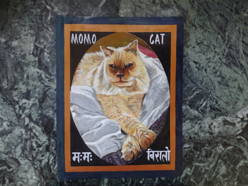 Folk art portrait of a Himalayan Cat hand painted on metal in Kathmandu, Nepal