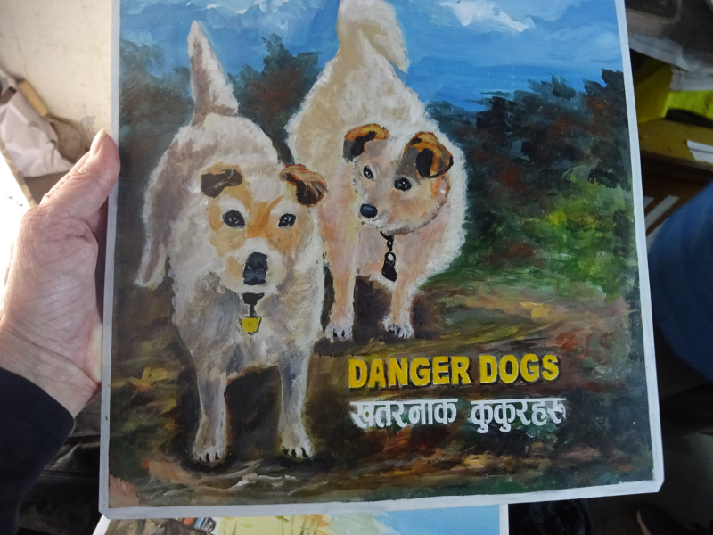 Folk art portrait of Jack Russell Terriers hand painted on metal in Nepal
